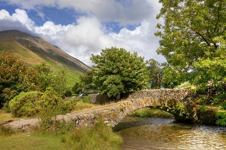 The old packhorse bridge at Wasdale Head near Wast Water, the Lake District, Cumbria, England