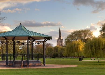 avon: Bandstand and church at Stratford upon Avon, Warwickshire, England.