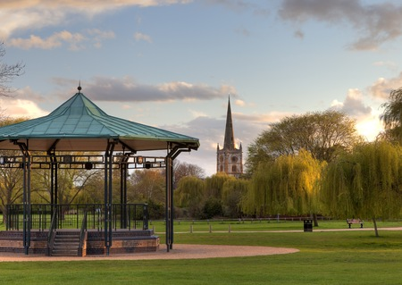 Bandstand and church at Stratford upon Avon, Warwickshire, England.