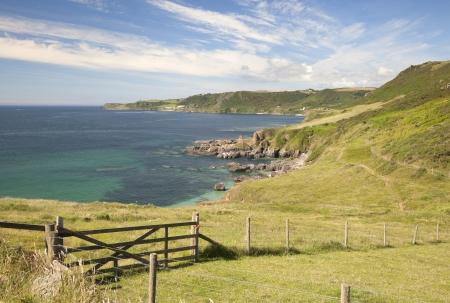 Farm gate overlookng Great Mattiscombe Sand, Devon, England