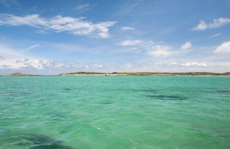 scilly: The beautiful emerald sea  in summer at the Isles of Scilly, Cornwall, England. Stock Photo