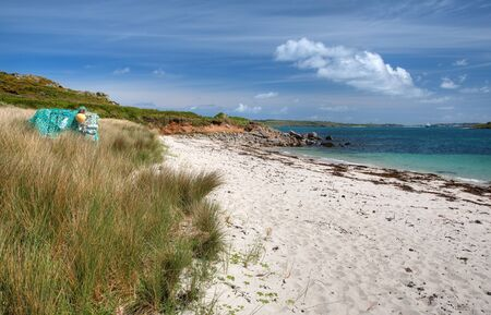 scilly: The white sandy beach at Rushy Bay, Bryher, Isles of Scilly, Cornwall, England.