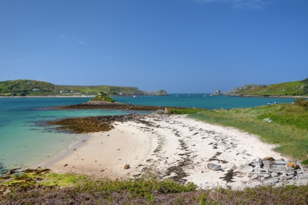 scilly: Looking towards Plumb Island and Cromwell's Castle, Tresco, Isles of Scilly, Cornwall, England.