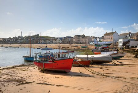 Fishing and sailing boats at St Mary's Harbour, St Mary's, Isles of Scilly, Cornwall, England.