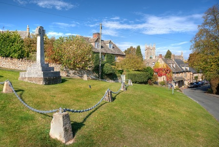 wold: The village cross at Longborough near Stow on the Wold, Gloucestershire, England.