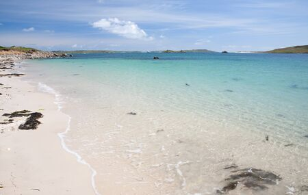 Crystal clear waters at Rushy Bay, Bryher, Isles of Scilly, Cornwall, England.