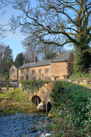 stow: Looking over the old bridge at Upper Swell near Stow on the Wold, Gloucestershire, England.