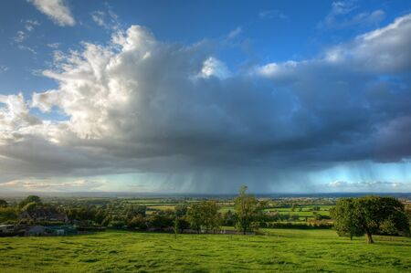 Rain clouds over rural Gloucestershire near Chipping Campden, England.