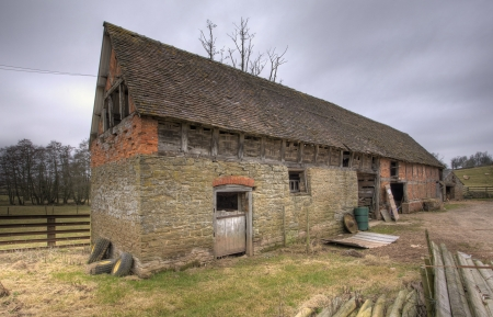 Stone barn with traditional wattle infill panels, Shropshire, England.