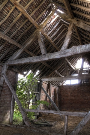 Timber-frame and brick constructed English barn interior. Stock Photo
