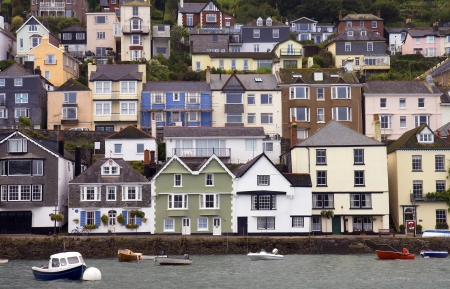 Houses stacked up the hillside at Dartmouth, Devon, England.