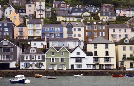 devon: Houses stacked up the hillside at Dartmouth, Devon, England.