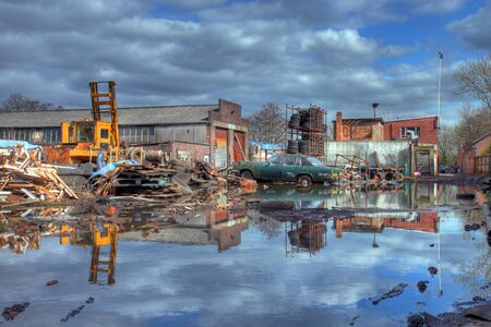 Scrapyard showing flood water and old car, Worcestershire, England. photo