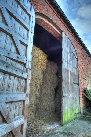 large doors: Large double doors set into brick constructed hay barn, Worcestershire, England.