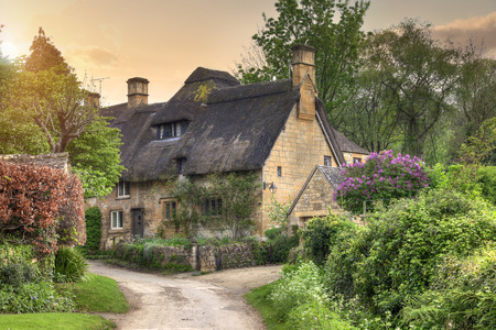 Pretty thatched Cotswold cottage in the village of Stanton, Gloucestershire, England