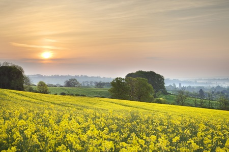 gloucestershire: Sunrise over a misty landscape towards the Cotswold town of Chipping Campden, Gloucestershire, England  Stock Photo