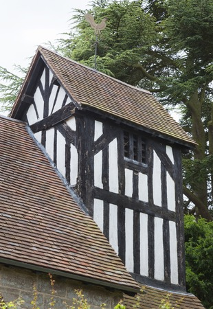 british isles: Wooden Bell Tower at Kington, Worcestershire, England Stock Photo