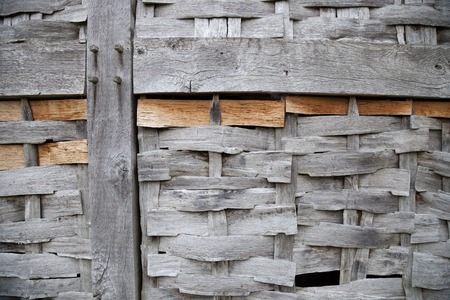 tenon: Timber-framed building with wattle panel, England.