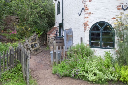 toll: Old toll house with traditional garden, England
