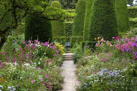 herbaceous border: Pretty cottage garden, Gloucestershire, England. Stock Photo