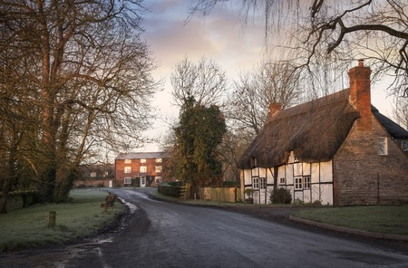 thatched cottage: Thatched cottage at Dorsington village, Warwickshire, England. Stock Photo