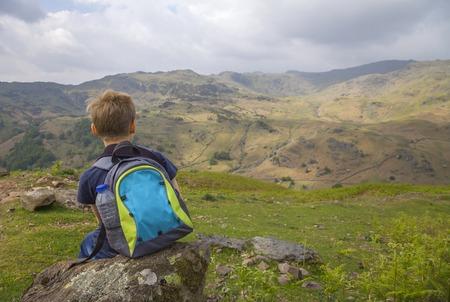 cumbria: Boy on Helm Crag, The Lake District, Cumbria, England