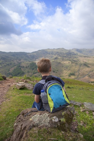 Boy on Helm Crag, The Lake District, Cumbria, England