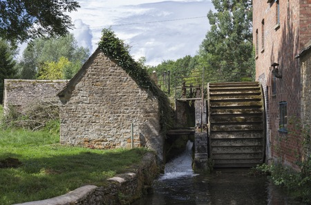 The Mill at Lower Slaughter, Cotswolds, Gloucestershire, England. Reklamní fotografie - 86481924