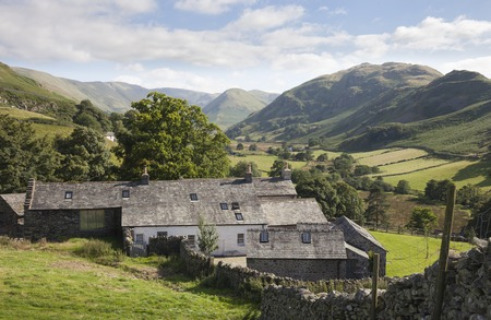 cumbria: Old farm from Hallin Fell with Howe Grain in background, the Lake District, Cumbria, England. Stock Photo