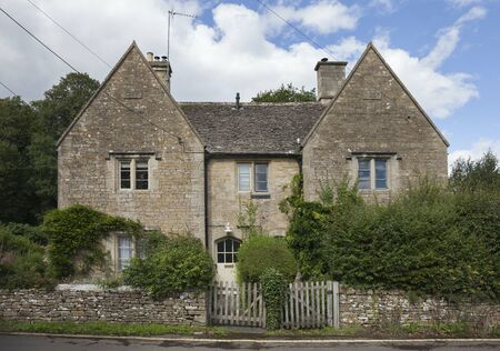 Stone, semi-detached cottages in Lower Slaughter village, Gloucestershire, England.