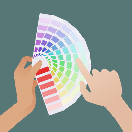 color guide: Female hand holding the color guide and pale male hand picks the shade