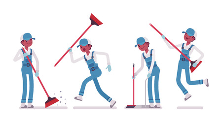 Male janitor sweeping the floor with a broom