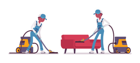Male janitor vacuum cleaning indoors