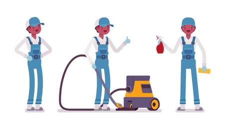 Male janitor standing with vacuum cleaner
