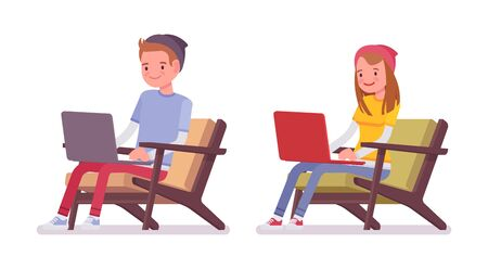 Teenager boy and girl sitting with laptop Stock Photo