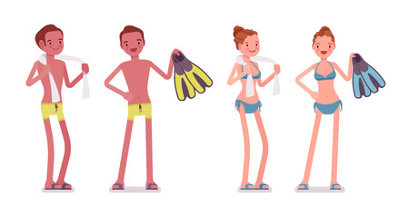 Standing young man and woman with towel and flippers set Lizenzfreie Bilder