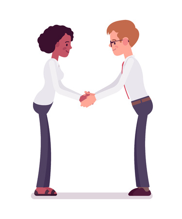 Male and female clerks handshaking with both hands