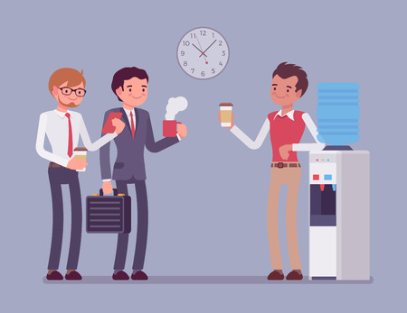 Office cooler chat. Young male workers having informal conversation around a watercooler at workplace, colleagues refreshing during a break.