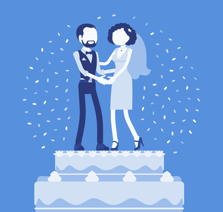 Wedding rich iced cake with bride and groom on top