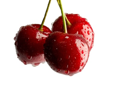 Cherry with water drop on white Stock Photo