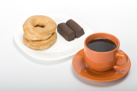 Coffee cup and cake in saucer Stock Photo