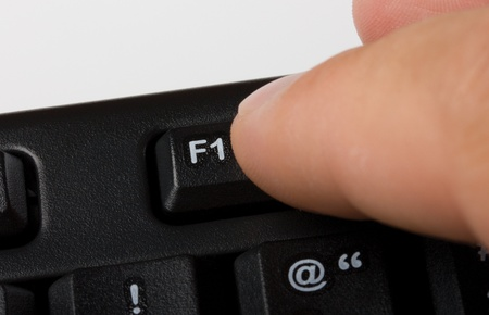 Finger pressing F1-key on a keyboard because of needing some help