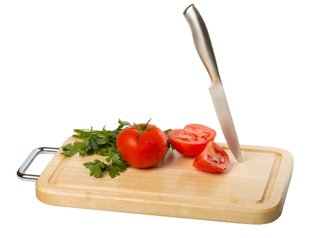 cutting board with tomato isolated on white background Stock Photo