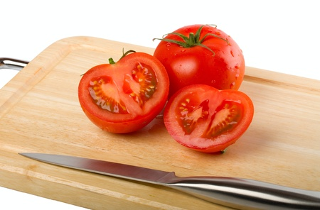 Cutting board with tomatoes isolated on white background