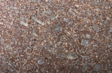 Granite background texture in brown and grey