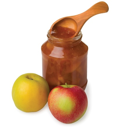 Apple jam in the pot with a wooden spoon