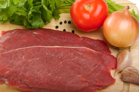 Fresh raw beef steak on wooden cutting board top view Stock Photo