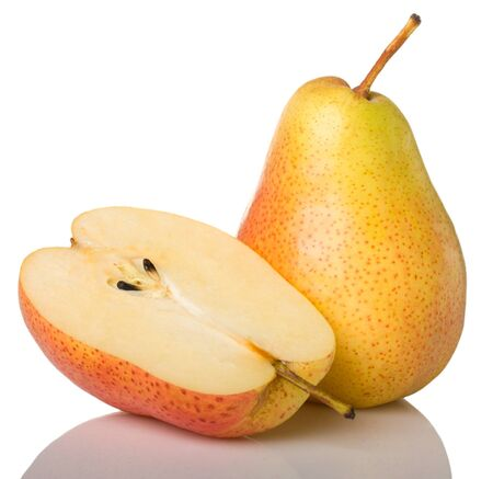 Yellow pear and half isolated on white background Stock Photo