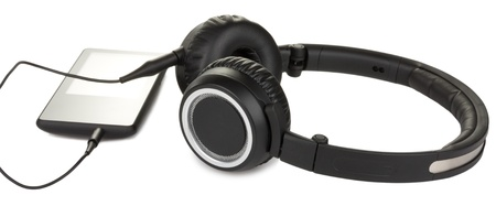 media player and headphones isolated on white background Stock Photo