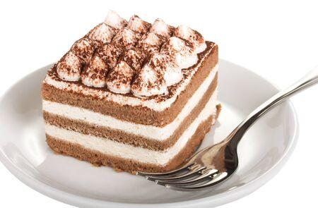 Tiramisu cake on plate with fork isolated on white Stock Photo